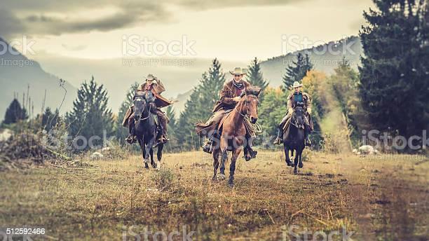 Three horseback riders galloping across a field picture id512592466?b=1&k=6&m=512592466&s=612x612&h=jotz6 ooyfudcqnv4nqotdstj49dbwpo vz960twsda=