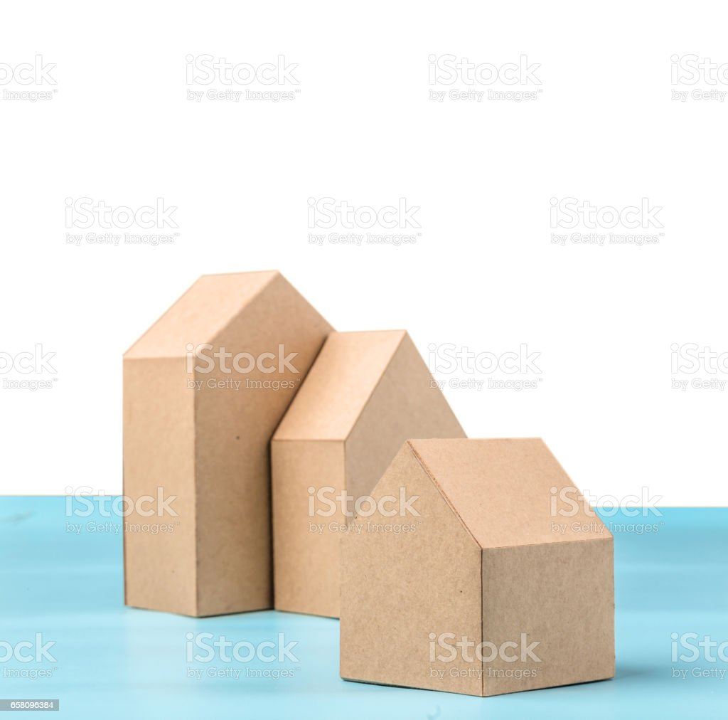 Three House Model Cardboard With Free Copyspace Stock Photo