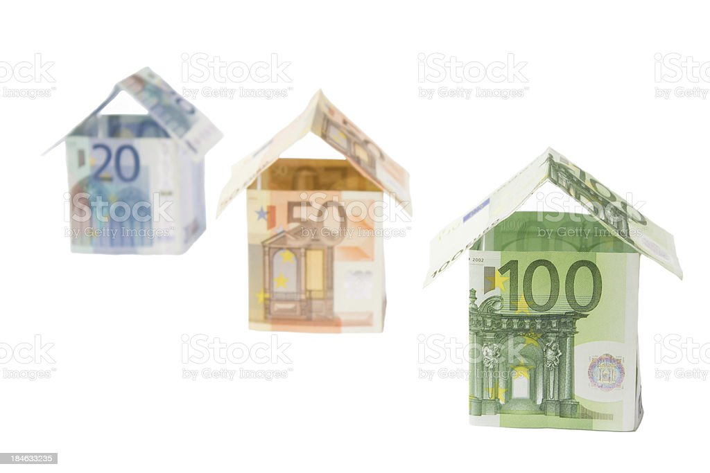 Three houses made of euro notes royalty-free stock photo