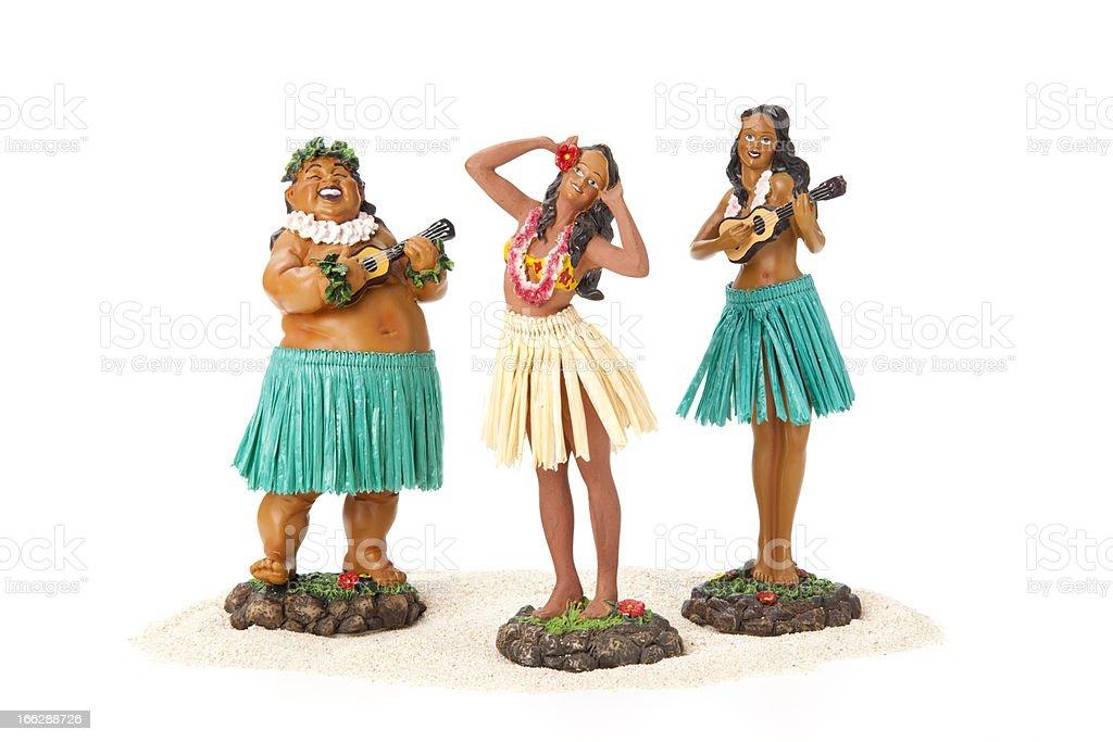 Three hula dancer figurines on white background stock photo
