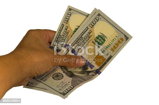 istock Three hundred dollars in a hand isolated on white background 858049654