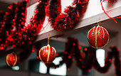 istock Three hunging red christmas balls 937562370
