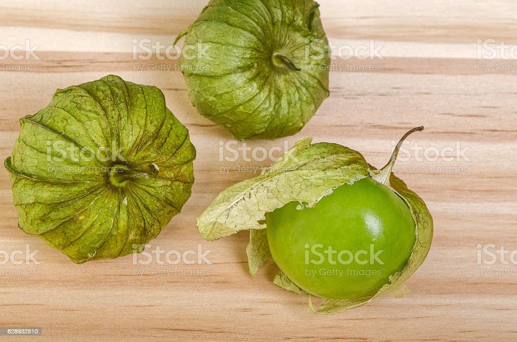 Three Husk Tomatoes stock photo