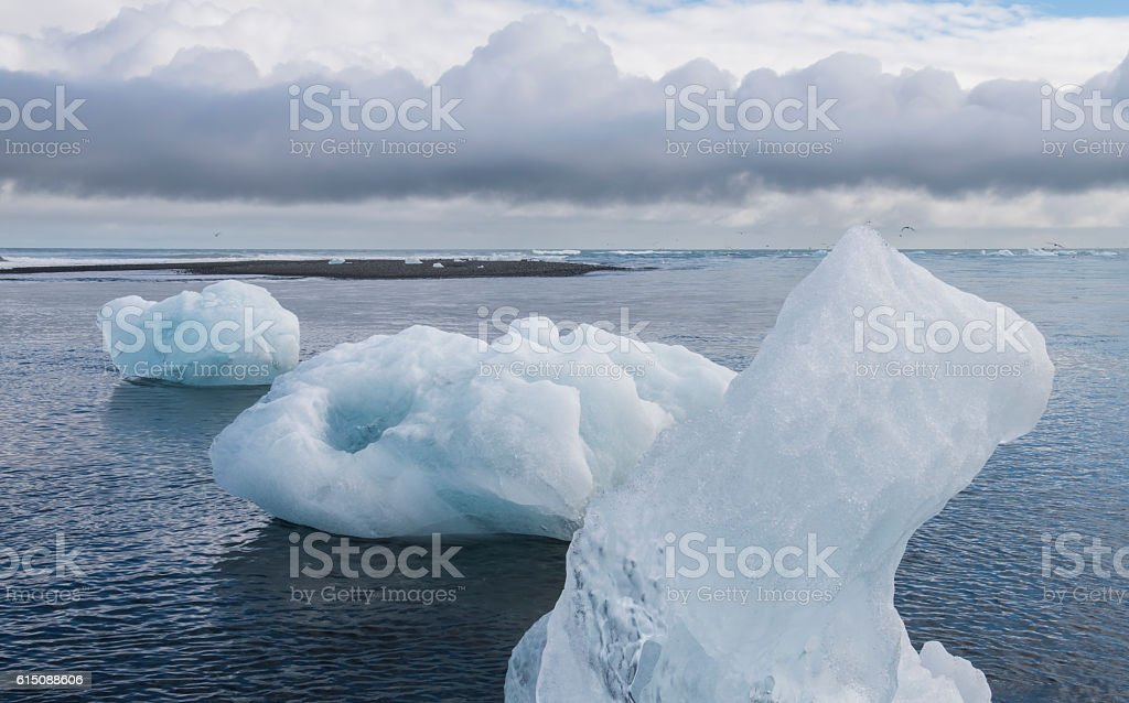 Three Ice Blocks on Beach, Iceland stock photo