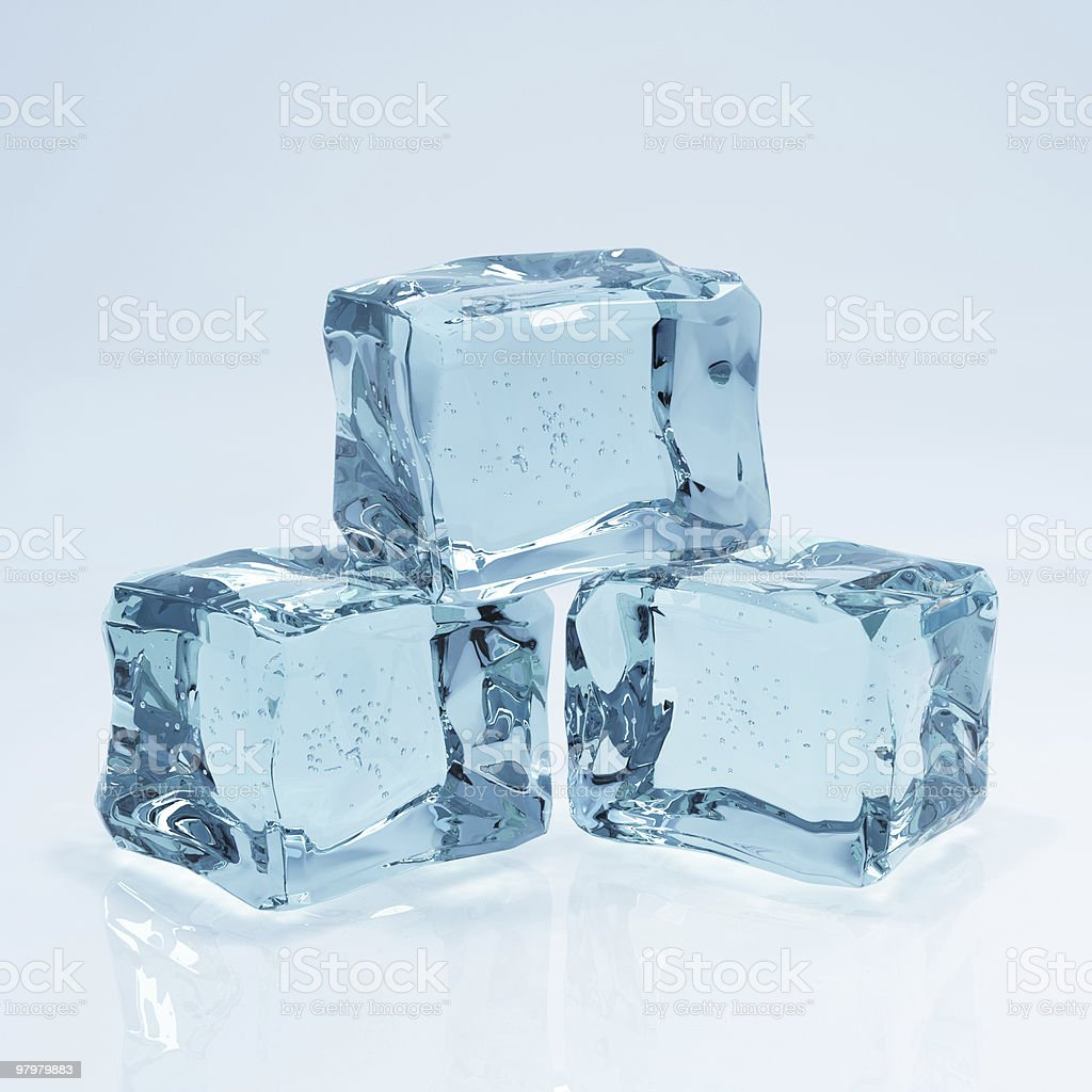 three ice cubes on blue background royalty-free stock photo