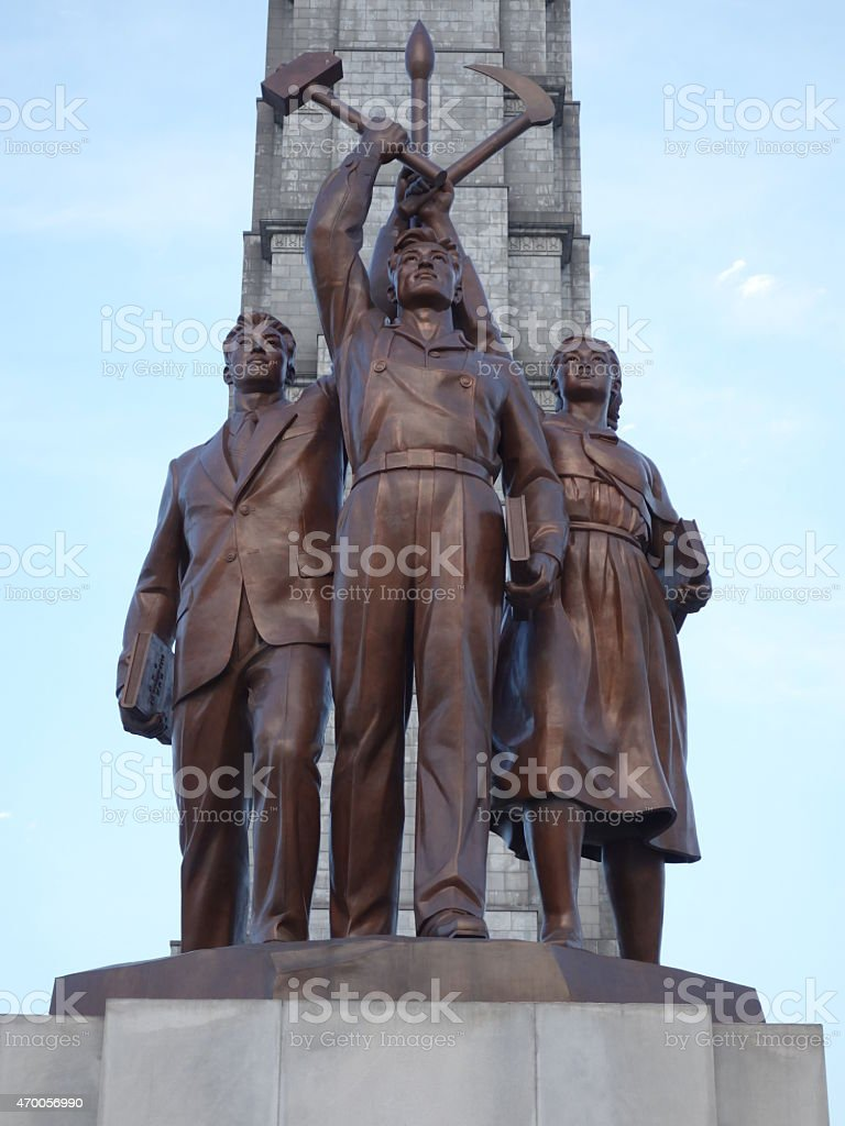 Three idealised figures in front of The Juche Tower stock photo
