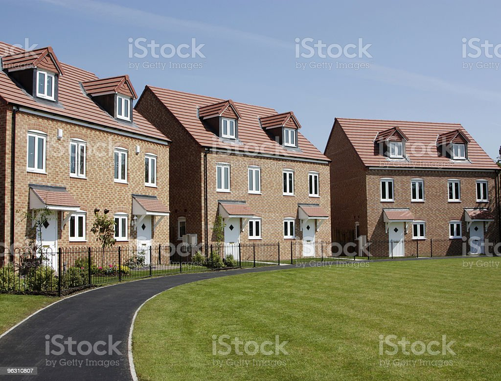 Three identical townhouse buildings with well groomed lawn stock photo