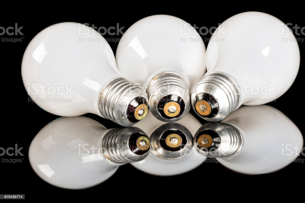 Three incandescent light bulbs in a row royalty-free stock photo