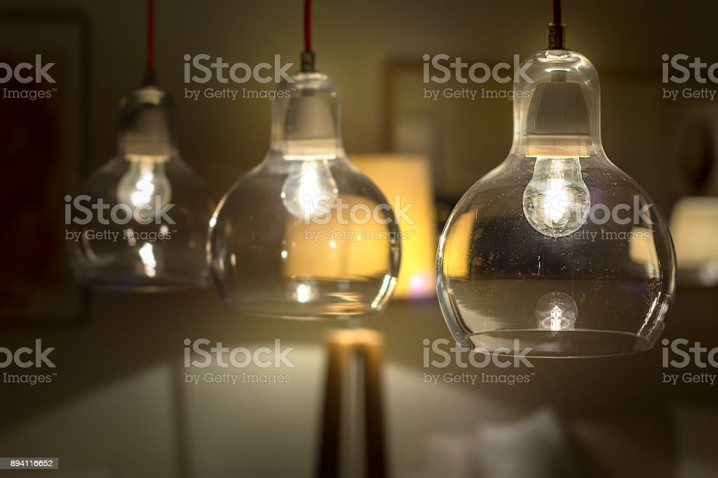 Three incandescent lights stock photo