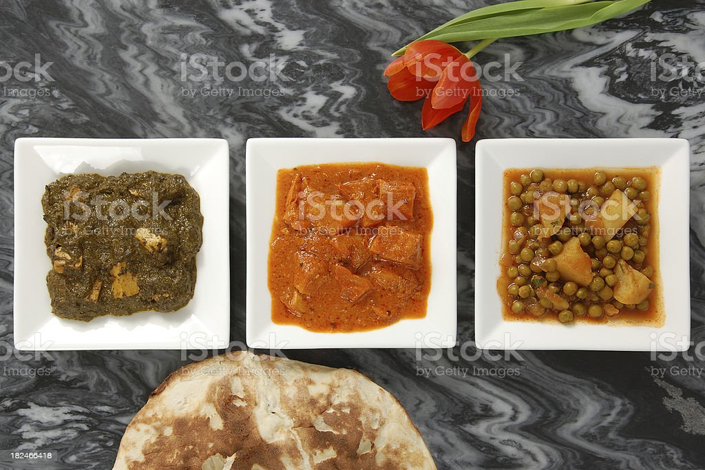 Three Indian Curries and Naan royalty-free stock photo