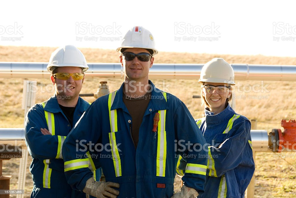 Three industrial workers using protection equipment royalty-free stock photo