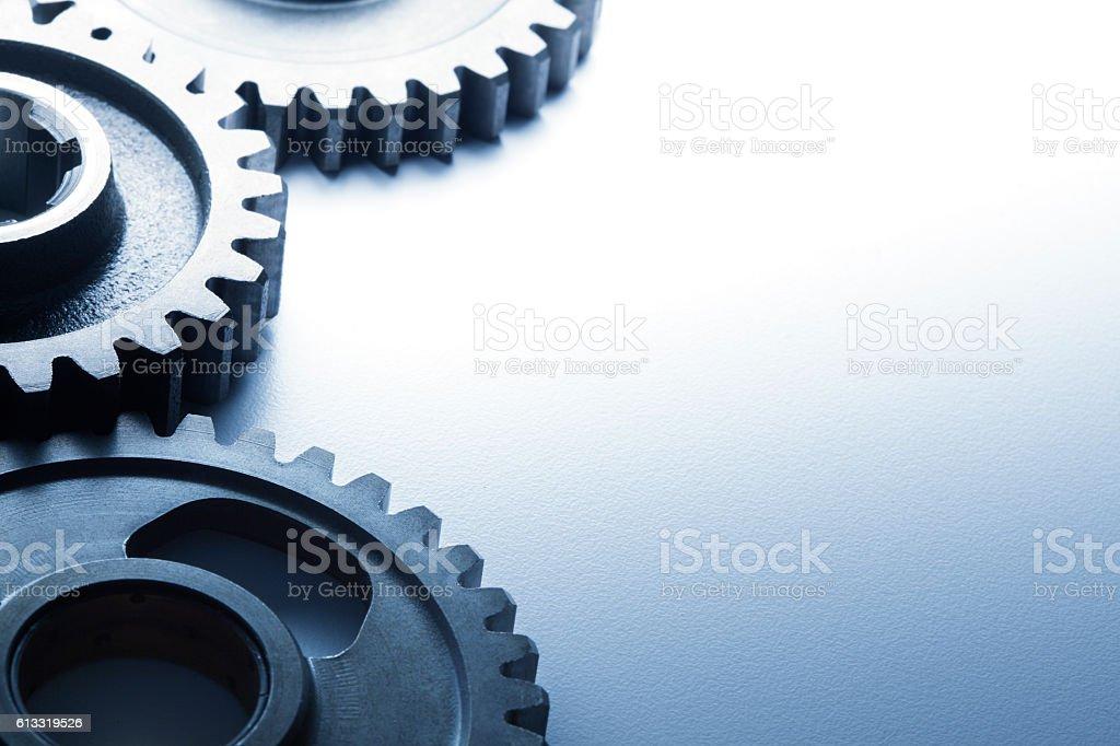 Three Interlocking Gears On White Background stock photo