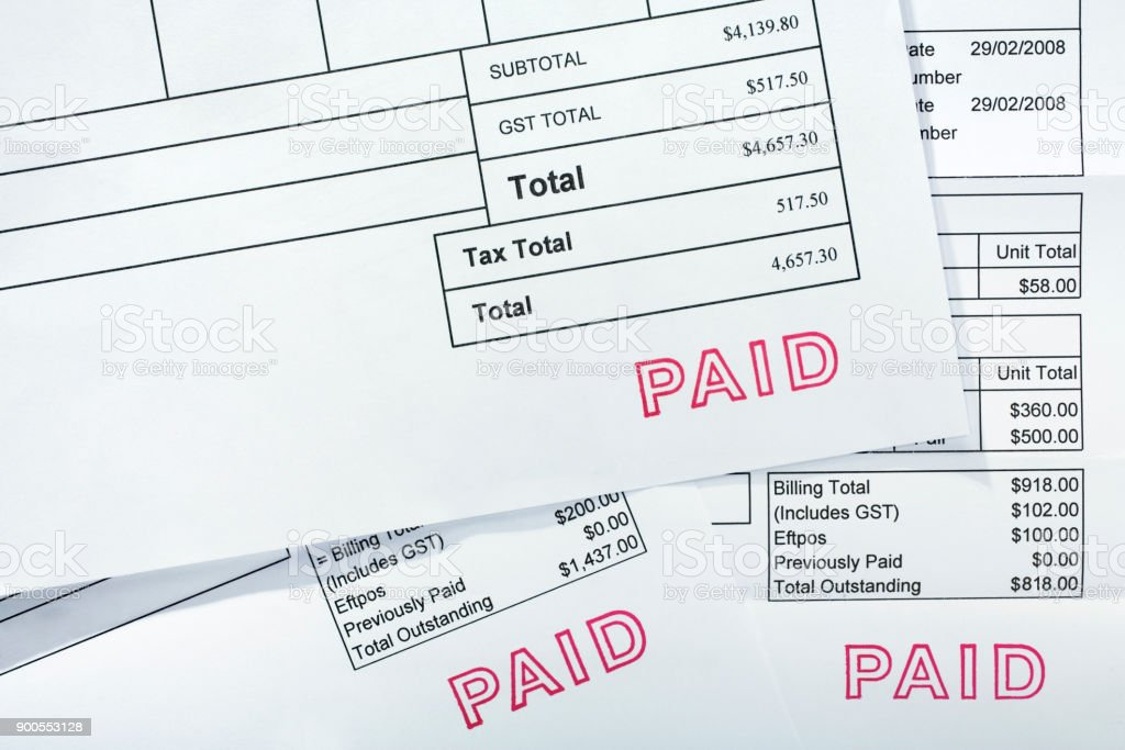 Three Invoices All With Paid Stamp stock photo