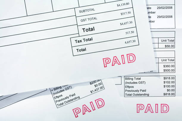 three invoices all with paid stamp - financial bill stock photos and pictures