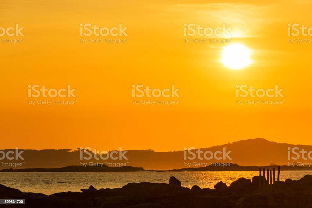 Three islands at sunset stock photo