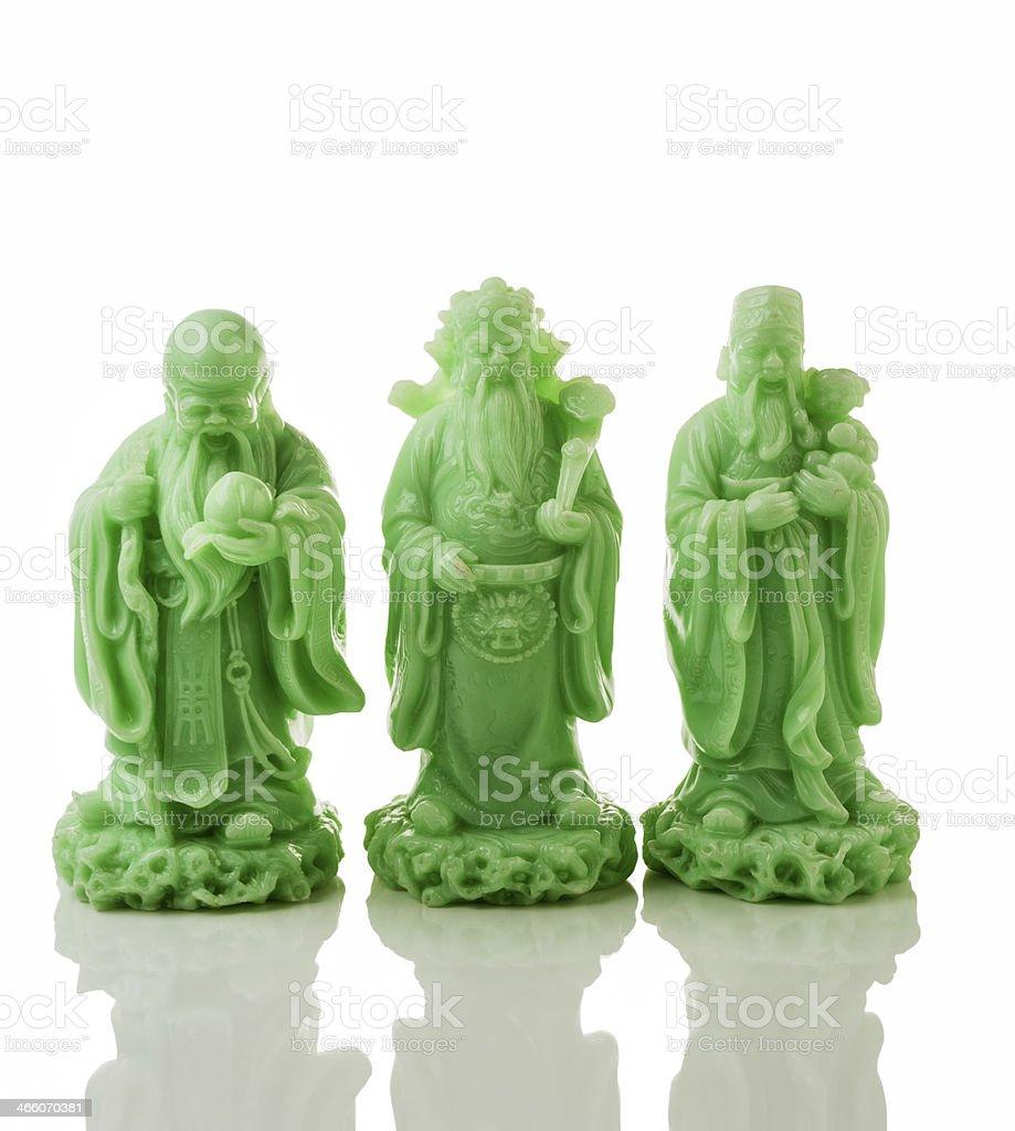 Three jade God statues stock photo