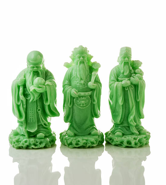 Three jade God statues stock photo