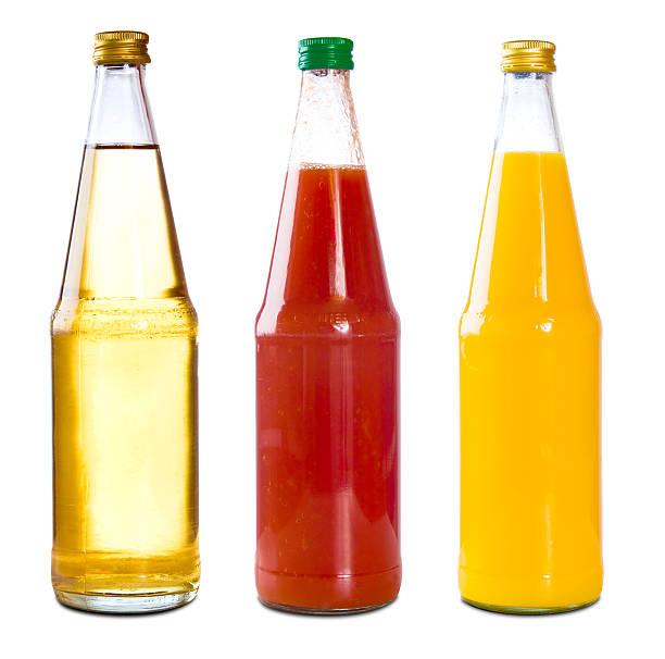 tre bottiglie di succo di mela, pomodoro, arancione - fruit juice bottle isolated foto e immagini stock