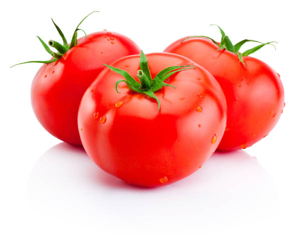 Three juicy red tomatoes isolated on white background stock photo