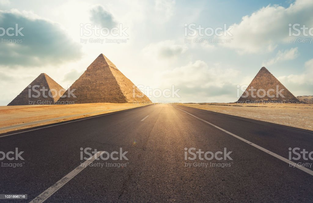 three Khufu pyramids  and road in Cairo, Egypt stock photo