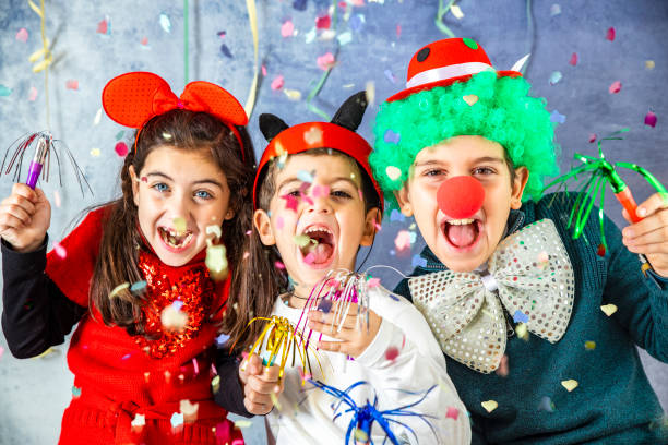 Three kids celebrating Carnival  together at home Three kids celebrating Carnival  together at home costume stock pictures, royalty-free photos & images