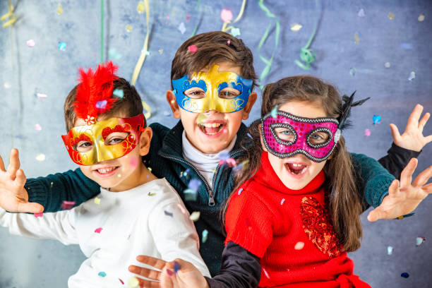 Three kids celebrating Carnival  together at home Three kids celebrating Carnival  together at home carnival children stock pictures, royalty-free photos & images