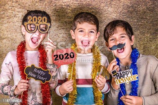istock Three kids celebrating New Years Eve. 2020! 1187799504