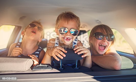 istock Three kids having fun on road trip 664584858