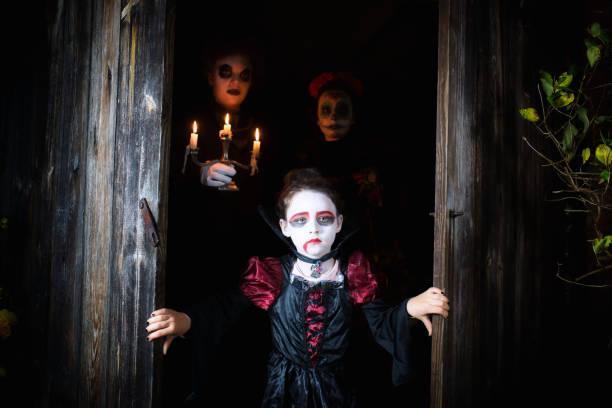 Three kids in spooky halloween costumes in door of barn picture id1028200028?b=1&k=6&m=1028200028&s=612x612&w=0&h=0bmxq6odtqu864voiqwrx5dktvwp fc4buk9yy3p2a8=