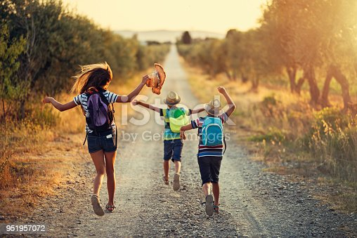 It's Vacations! Three kids running on last day of school.  Nikon D810