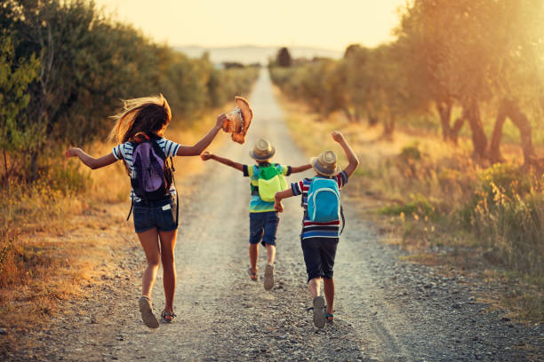 three kids running on last day of school - finishing stock photos and pictures