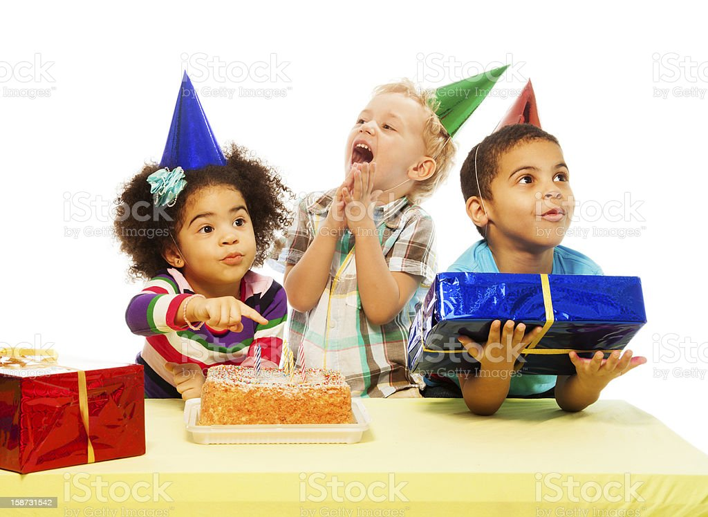 Three kids with birthday cake and peresents royalty-free stock photo