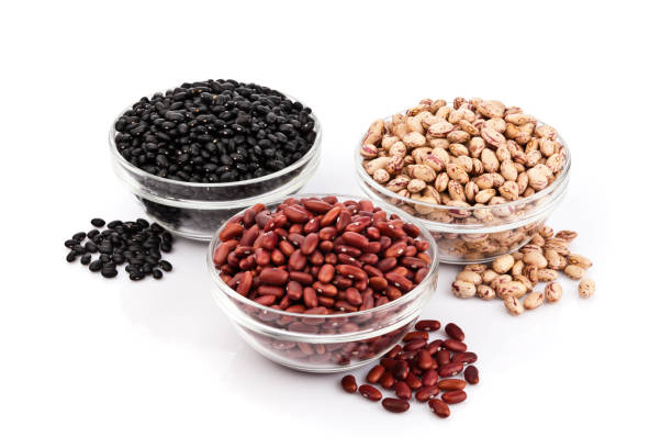 three kinds of beans on white background - bean stock photos and pictures