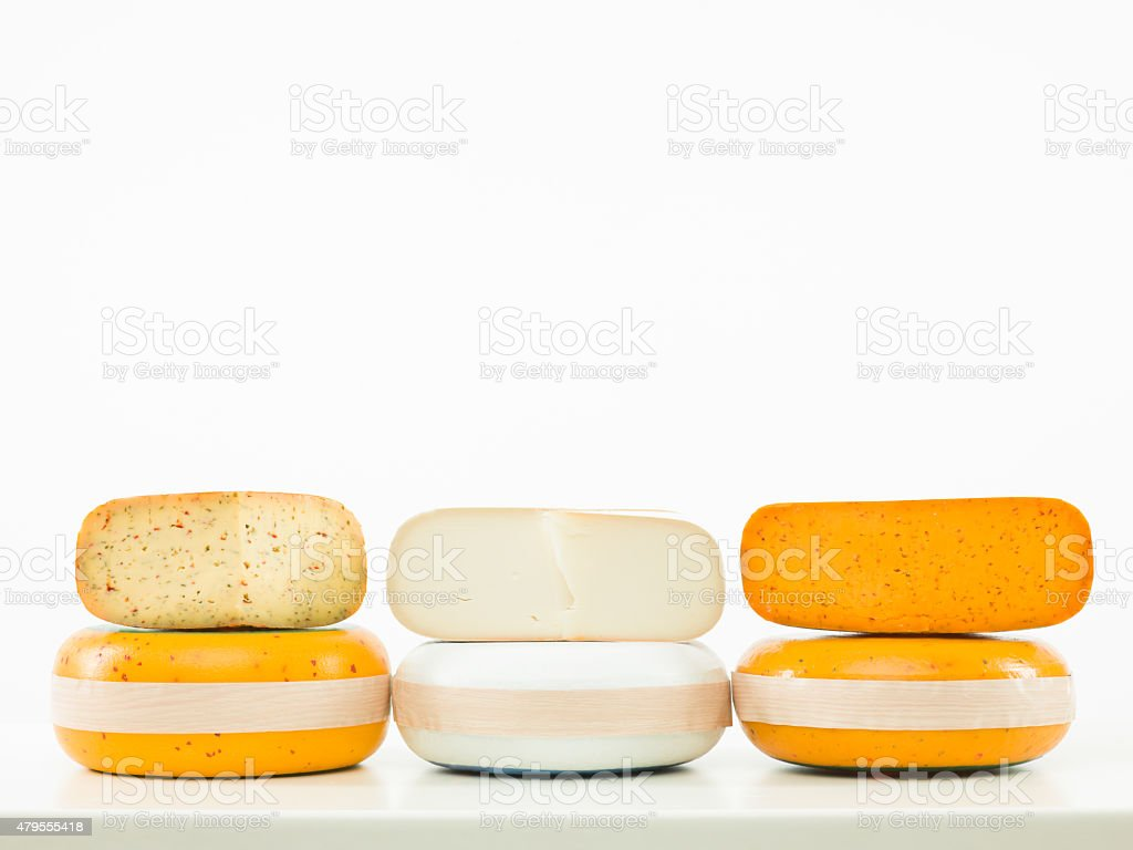 three kinds of cheese arranged in line stock photo