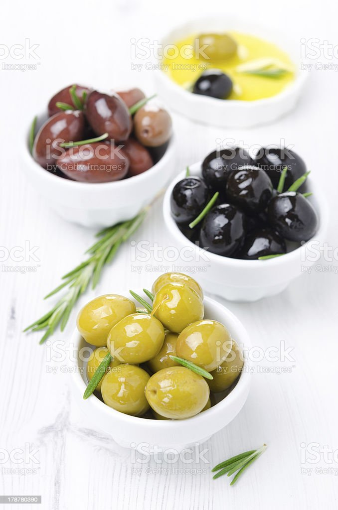 three kinds of olives, fresh rosemary and olive oil royalty-free stock photo