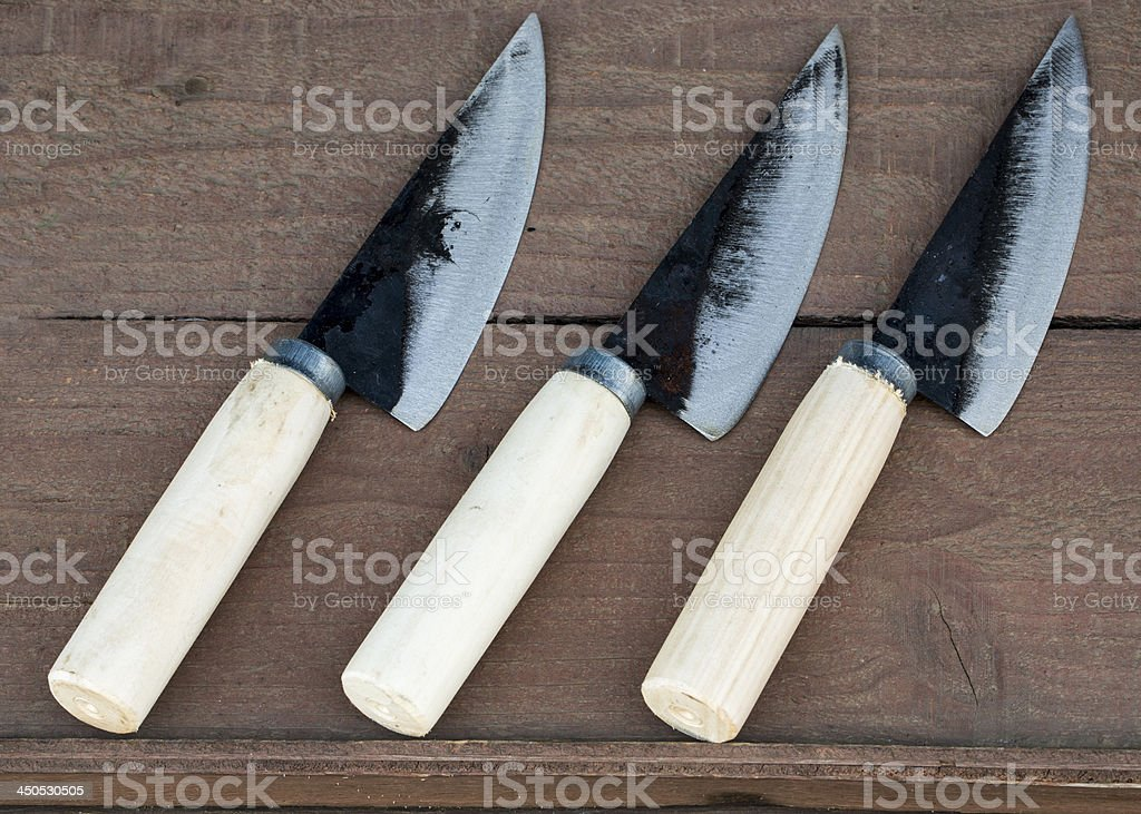 three knife on wooden plate stock photo