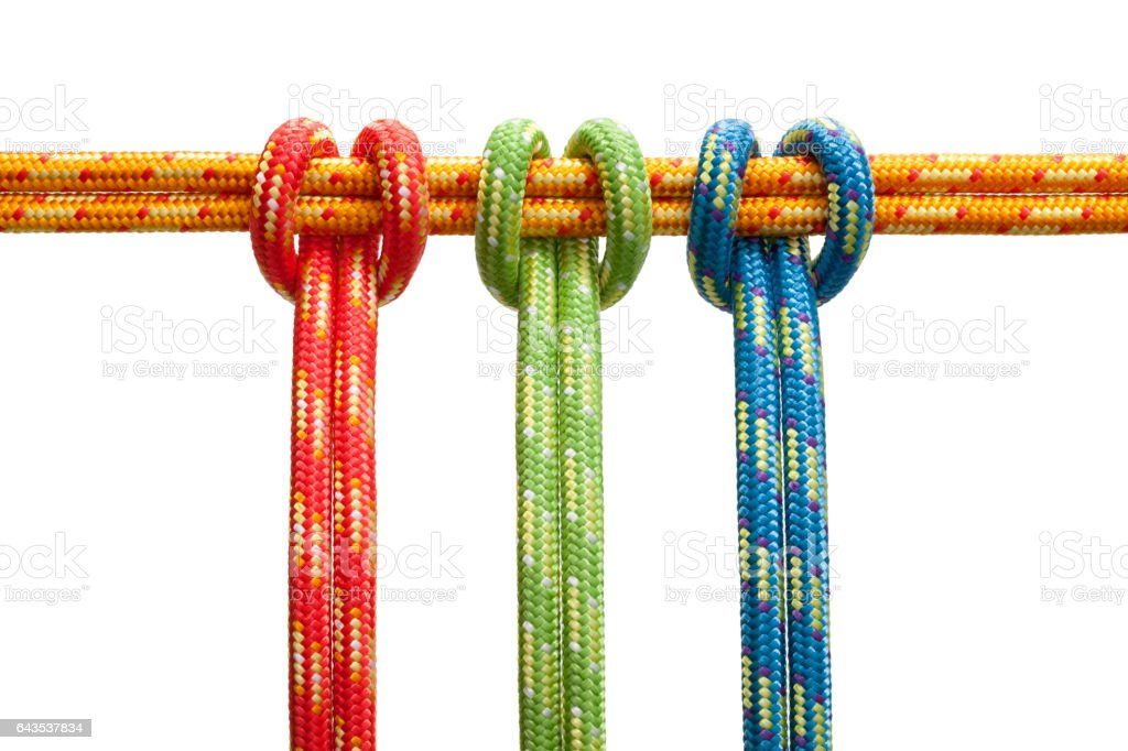 Three knots with colored ropes stock photo