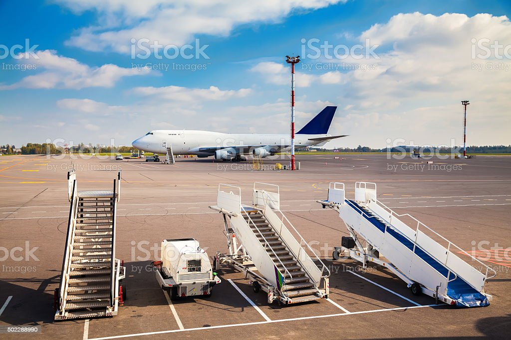 three ladders in the airport stock photo