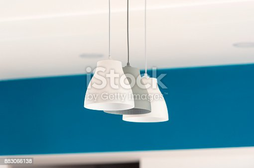 istock Three lamps hanging from the ceiling, interior, living room 883066138