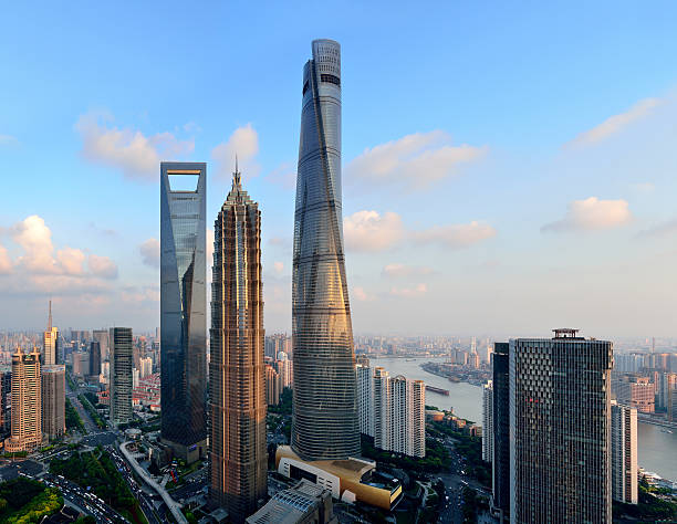 Three Landmark Skyscraper at sunset, Shanghai Shanghai three landmark skyscraper in the lujiazui financial district at sunset, China. jin mao tower stock pictures, royalty-free photos & images