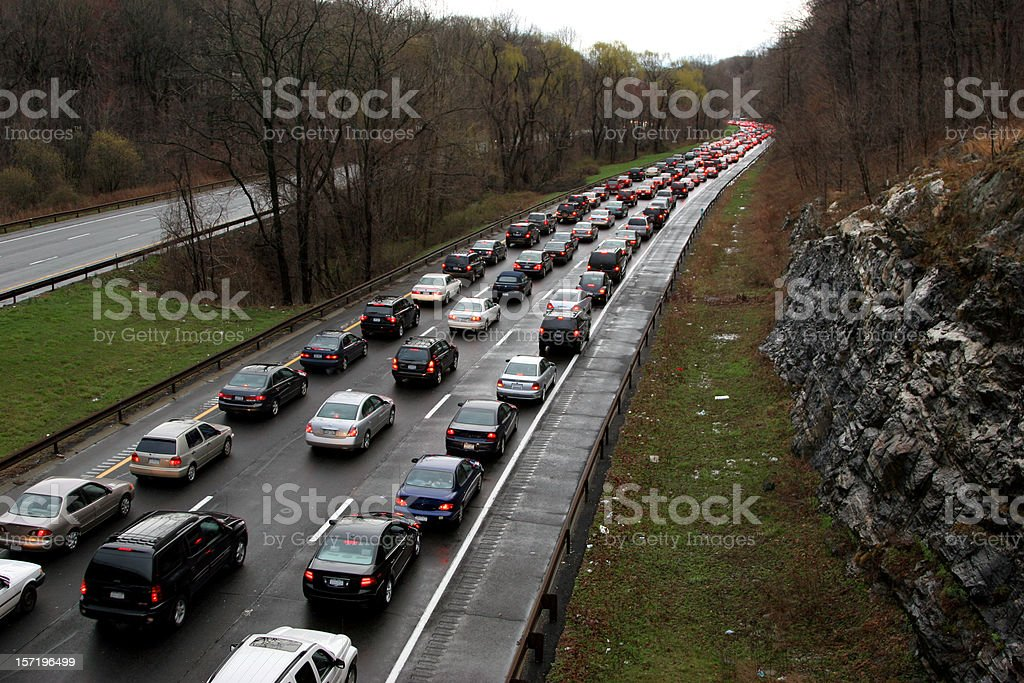 Three lane road with traffic next to empty road royalty-free stock photo