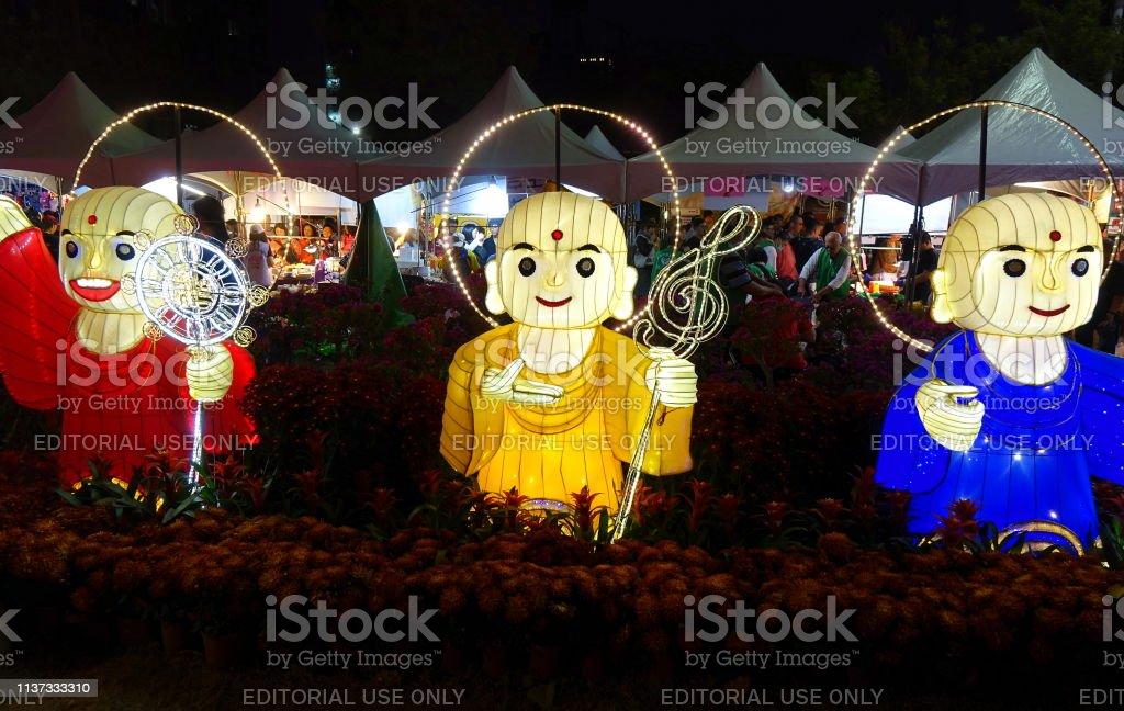 Three Lanterns in the Shape of Buddhist Monks stock photo