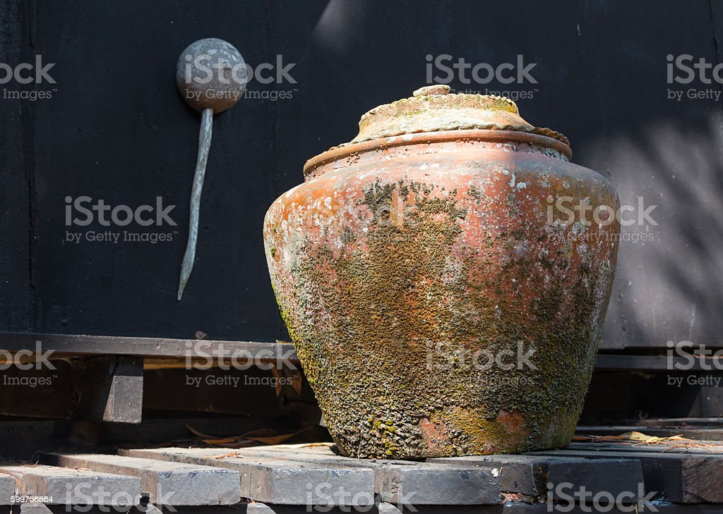 three large cooking pots on fires with smoke stock photo
