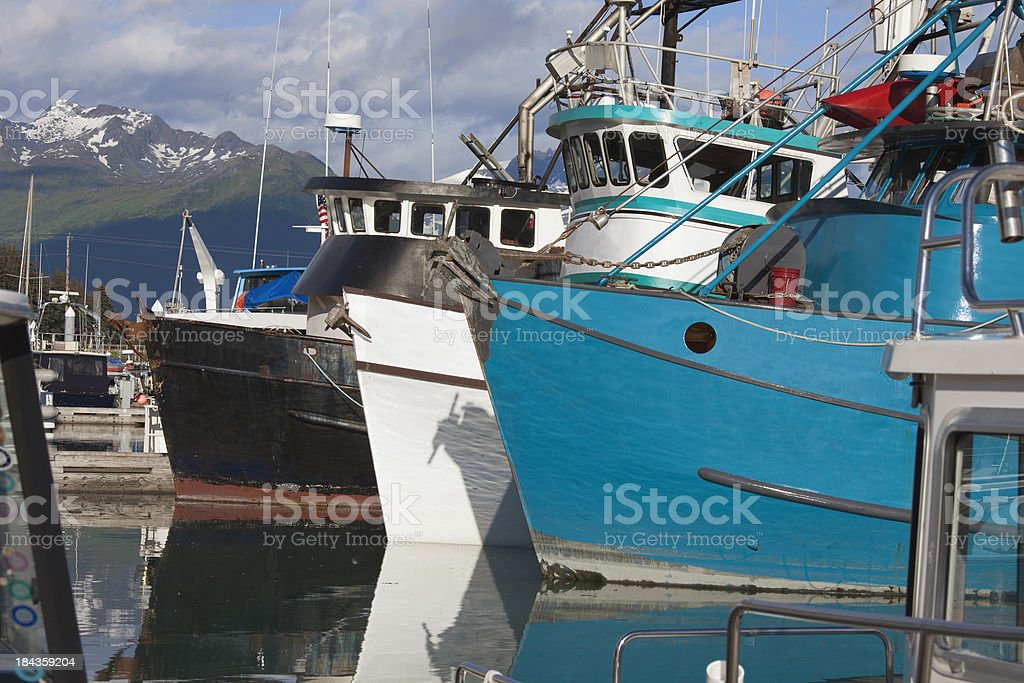 Three large fishing boats anchored in Valdez Harbor stock photo