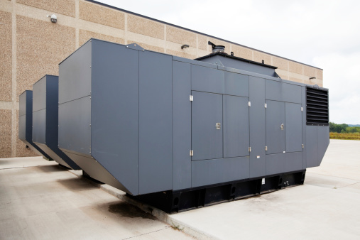 Three large industrial emergency power standby generators. This configuration could power a large facility such as a hospital, school even a small city.
