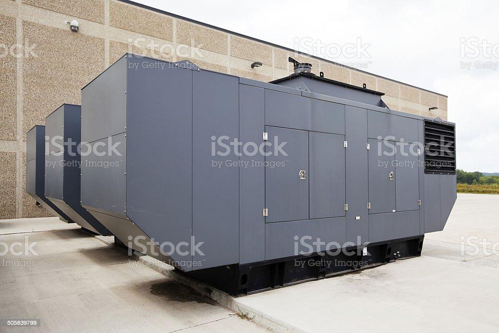 Three Large Industrial Emergency Power Standby Generators stock photo
