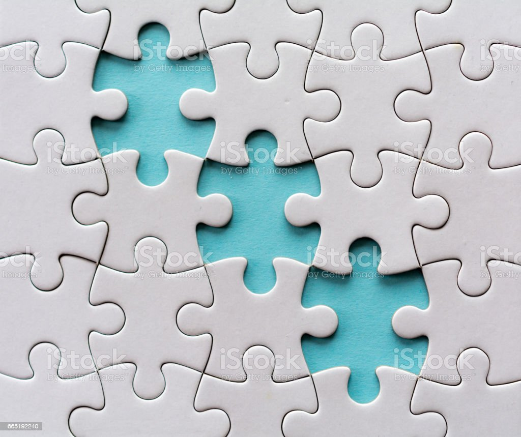 Three last diagonal pieces of a blank jigsaw puzzle stock photo