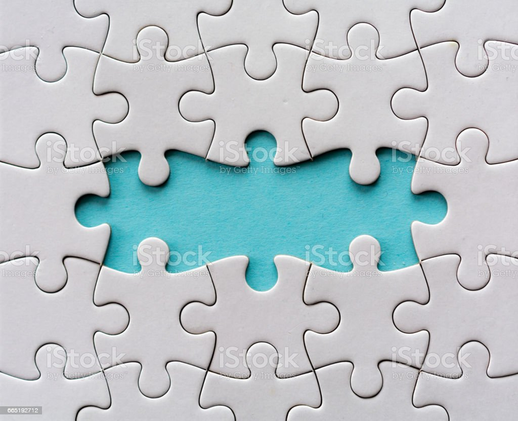 Three last pieces of a blank jigsaw puzzle stock photo