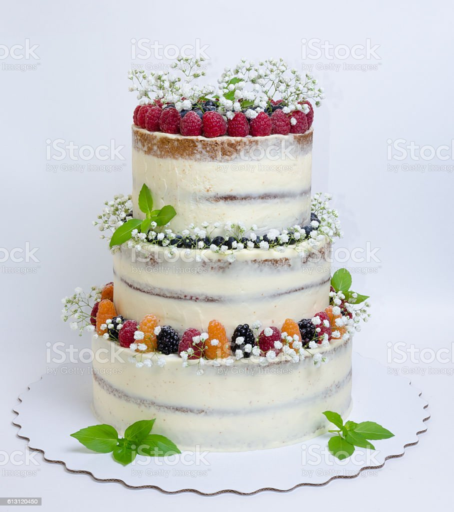 Three Layered Wedding Cake With Berries And Basil Leaves Stock Photo ...