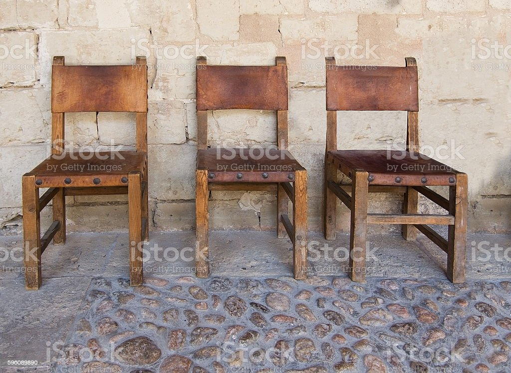 Three leather and wood chairs royalty-free stock photo